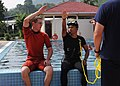 Flickr - Official U.S. Navy Imagery - a surface rescue swimmer demonstrates proper rescue swimmer hand signals to a member of the Malaysia Maritime Enforcement Agency..jpg