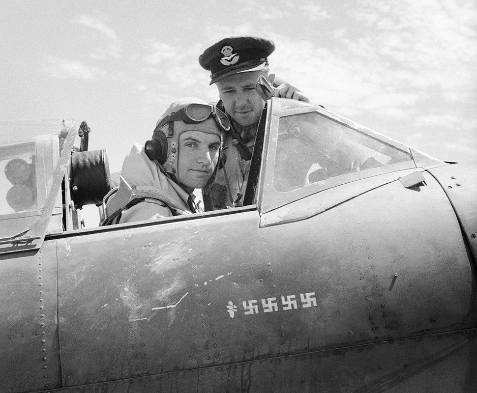 Flight Lieutenant Dennis Barnham of No. 601 Squadron RAF in the cockpit of his Supermarine Spitfire Mk VB at Luqa, Malta, with Pilot Officer M H Le Bas, June 1942. GM1001