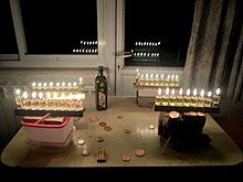 Four oil menorahs, eighth night of Hanukkah.jpg