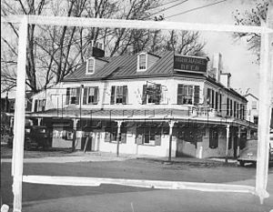 Fox Chase, Philadelphia - The exterior of the Old Fox Chase Hotel, long a familiar landmark at the bending intersection of Oxford Avenue and Pine Road, near Rhawn. The hotel, built in 1705, developed a thriving stage coach business with the opening of the Fox Chase and Huntingdon Turnpike in 1848. Before 1870 it was owned by Elijah Hoffman, who operated it for many years. The hotel was sold and razed in 1940 to make way for a gasoline station.