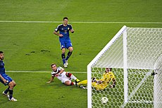 Götze kicks the match winning goal.jpg