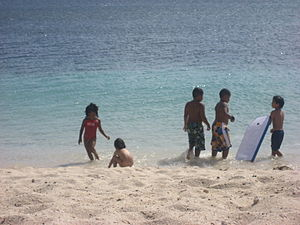 Kids playing at the beach in San Cristoban