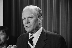 Gerald Ford speaking into microphones, 9 Aug 1974.jpg