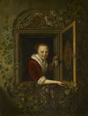 A Girl with a Bunch of Grapes at a Window