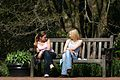 Girls Sitting In Summer Sun At RHS Wisley Surrey UK.jpg