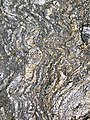 Gneiss (Archean; Norris South roadcut, Madison County, Montana, USA) 4 (44803634004).jpg
