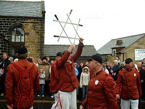 Weapon dance - Boxing Day 2005 – The Grenoside Sword Dance Captain holds aloft the sword lock before placing it around his neck