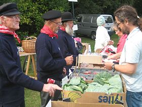 Guernseymen selling produce at the Viaer Marchi.jpg