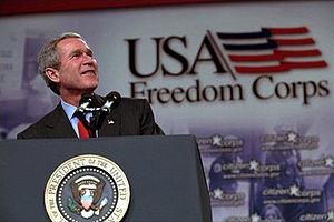 USA Freedom Corps - George W. Bush speaks in front of a USA Freedom Corps display.