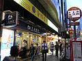HK Mongkok night Nathan Road 688 華僑商業中心 Hua Chiao Commercial Centre Bank of Comm bus stop sign a.jpg
