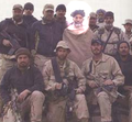 Hamid Karzai (highlighted) with American Special Forces.png