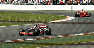2007 British Grand Prix - Hamilton leads the early stages of the Grand Prix, ahead of winner Kimi Räikkönen.