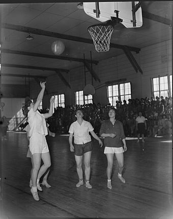 A basketball game between the Heart Mountain and Powell High School girls teams, Wyoming, March 1944 Heart Mountain Relocation Center, Heart Mountain, Wyoming. A hotly contested interscholastic basket . . . - NARA - 539726.jpg