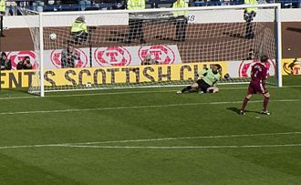 Penalty shoot-out (association football) - Steven Pressley scores for Hearts against Gretna in the 2006 Scottish Cup Final shoot-out