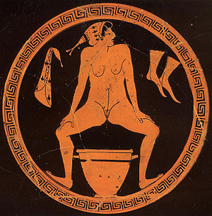 """Foundry Painter - Hetaira urinating into a vessel, tondo of a kylix """"in the style of the Foundry Painter"""", ca. 480 BC. Berlin, Antikensammlung."""