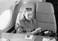 Hillary Rodham Clinton on plane using Game Boy (04).jpg