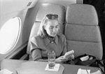 Hillary Rodham Clinton on plane using Game Boy (04).jpg