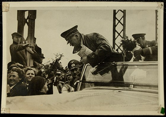 Hitler crosses the border into Austria in March 1938. Hitler Crosses into Austria in 1938.jpg