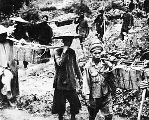 North Vietnamese invasion of Laos - The Ho Chi Minh trail from the very beginning was using Vietnamese and Laotian people as seen in a captured Vietcong's photo, circa 1959