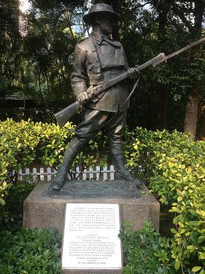 Statue of an anonymous World War I soldier from statuary collection of Eu Tong Sen. Also visible is the Battle of Hong Kong memorial plaque dedicated to all the defenders of Hong Kong in December 1941 through John Robert Osborn Hong Kong Park statue.jpg