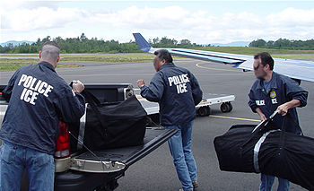 HSI Special Agents seizing narcotics during an...