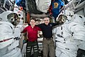 ISS-58 Anne McClain and David Saint-Jacques inside the Quest airlock (1).jpg