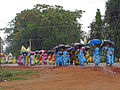India - Colours of India - Brightly clad SHG marching despite the rain (2485978224).jpg