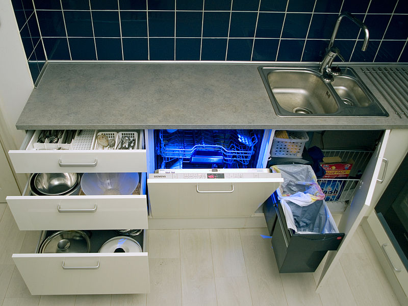 File:Integrated kitchen with lower cabinets open.jpg