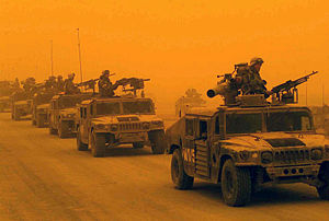 Dust storm - A convoy endures a dust storm in Iraq during the invasion of 2003.