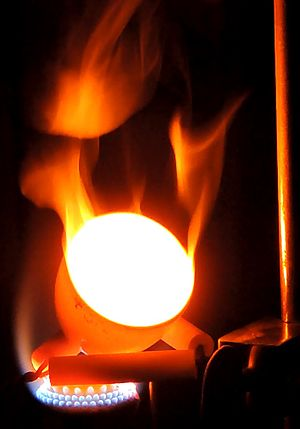 Flame test - An iron (III) flame, generated using the thermite reaction