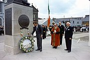 United States President John F. Kennedy laying a wreath at Commodore John Barry Memorial in Wexford, Ireland in 1963.