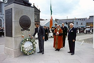 Frank Aiken - Wreath laying ceremony at Commodore John Barry Memorial. President Kennedy, Mayor of Wexford Thomas Burne, Minister of External Affairs of Ireland Frank Aiken, U. S. Ambassador to Ireland Matthew McCloskey, Naval Aide to the President Tazewell Shepard, others. Wexford, Ireland, Crescent Quay.
