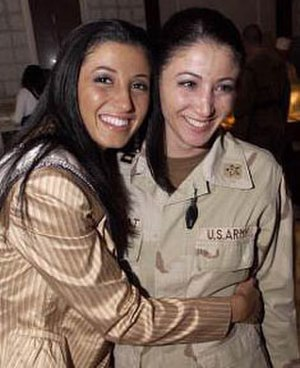 Miss New York USA - Miss New York USA 2004 Jaclyn Nesheiwat (left) visited U.S. troops in Iraq in March 2004.  While in Baghdad, she met her sister, Army Capt. Julie Nesheiwat (right).