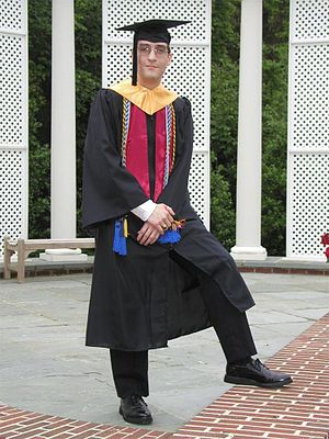 American academic dress is typically closed at the front and properly worn with the prescribed cap, as well as the hood. On the baccalaureate dress shown other items such as scarves, stoles or cords may be seen. - Academic dress