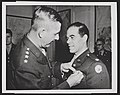 Jacob L. Devers presenting the Legion of Merit award to Frank Capra, 1943.jpg