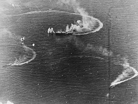 The Japanese aircraft carrier Zuikaku and two destroyers under attack in the Battle of the Philippine Sea Japanese aircraft carrier Zuikaku and two destroyers under attack.jpg