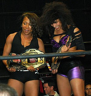 Jazz (wrestler) - Jazz (left) and Marti Belle as the WSU Tag Team Champions in March 2011.