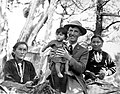 Jesse Nusbaum holding a Navajo child with two Navajo women in the background. (0f84f73b93b543ada8432d42c8f10645).jpg
