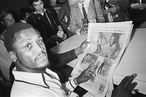 Joe Frazier reading newspaper