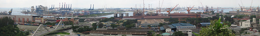 An industrial landscape with buildings and numerous cranes.