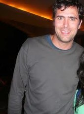 A color photo of Tim Rice-Oxley.