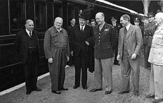 Godfrey Huggins - Huggins (second from right) with Canada's Mackenzie King, Britain's Winston Churchill, New Zealand's Peter Fraser, U.S. General Dwight D Eisenhower and South Africa's Jan Smuts, in England just before the Normandy landings in June 1944