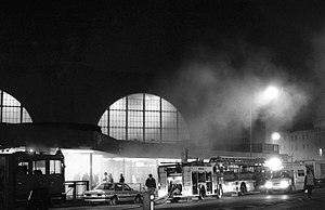 King's Cross fire, billowing smoke, station lights and fire engines.