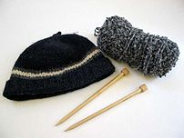 Photo of knitted hat, yarn, and k...