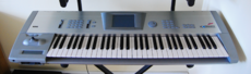 A grey colored synthesizer instrument