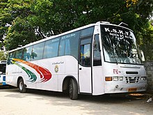 White bus with a tricolor swoosh