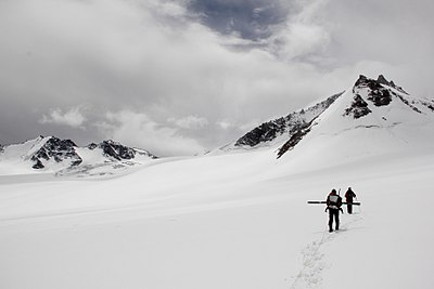 Kyrgyz and Swiss scientists continuing the mass balance measurements in Abramov glacier, Kyrgyzstan.jpg