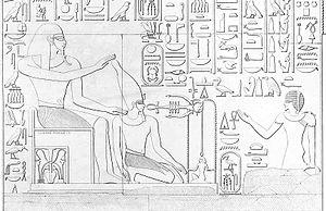 Dedun - Dedun (left) crowning Thutmose III (kneeling). Relief from the temple of Thutmose III in Semna