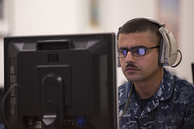 Man taking language test By U.S. Navy photo by Mass Communication Specialist 3rd Class Bryan Jackson. (https://www.dvidshub.net/image/1515144) [Public domain], via Wikimedia Commons