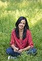 Liz Bonnin sitting in meadow 2 Credit Andrew Crowley.jpg